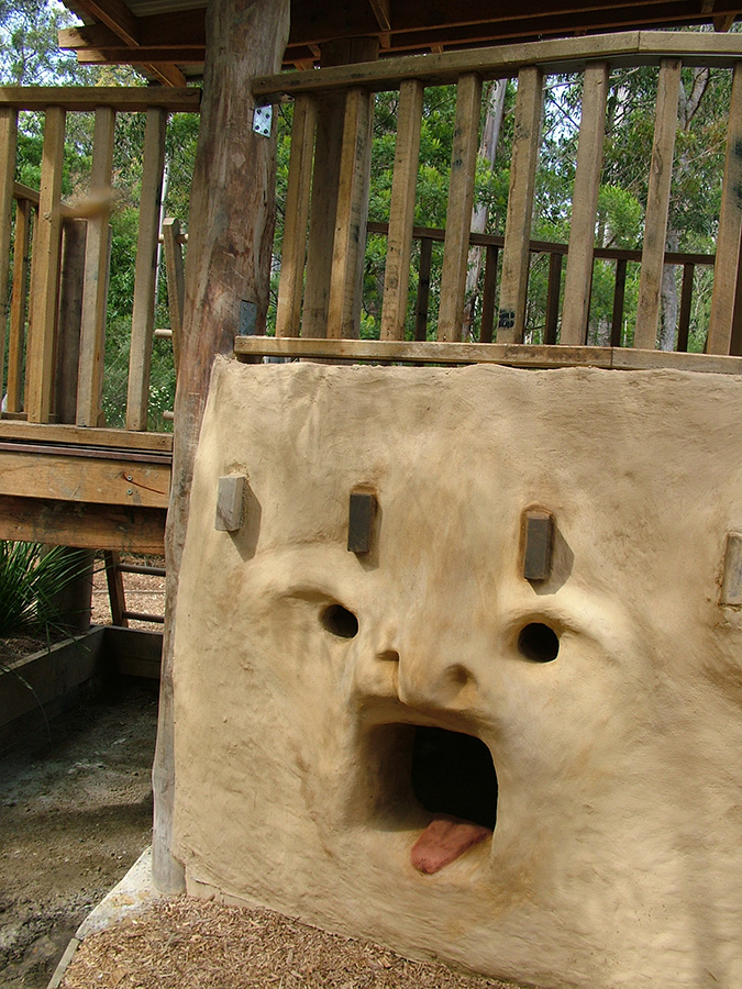 Mouth and eyes sculpted into the mud brick cubby