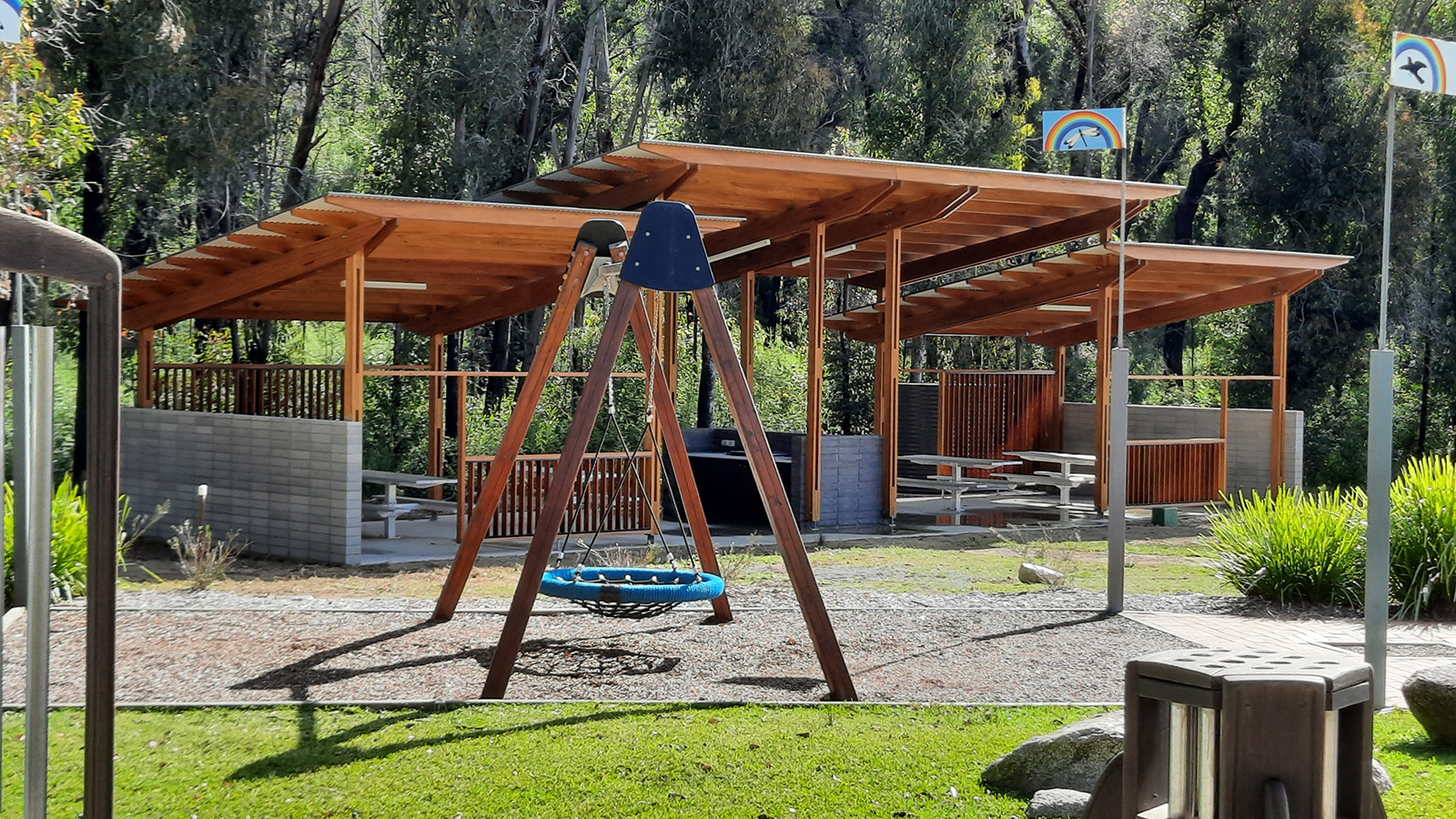 Swing play equipment and an outdoor barbecue shelter area